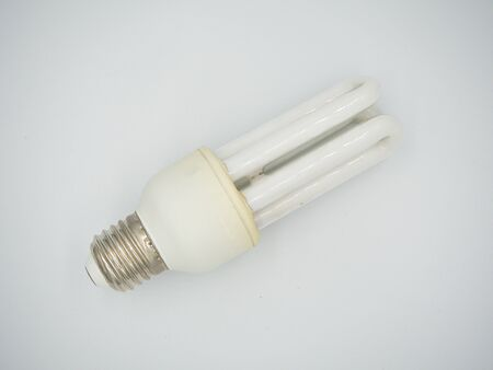 Top shot on the used energy saving bulb with showing both screw base and bulb with isolated white background