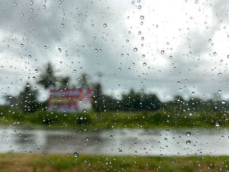 The water drop on the car window mirror after the rain