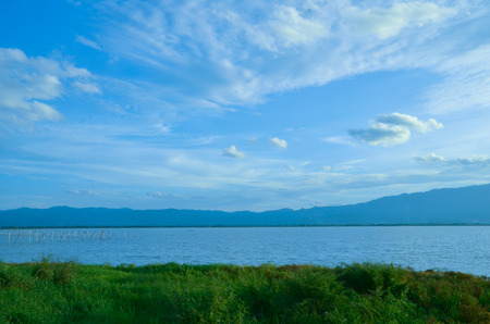 A view of Phayao lake with a cloudy blue sky