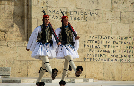 Evzone guards marching in front of greek parliament building in Athens, Greece Editorial