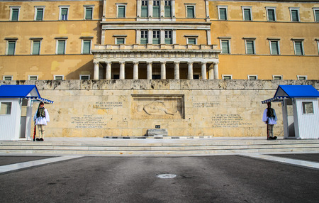 Evzone guards standing in front of greek parliament in Athens, Greece