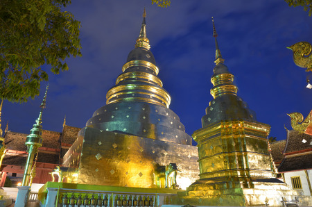 A night scene of grand golden chedi at Wat phra singh, Chiang Mai, Thailand