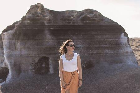 Woman on volcanic scenario
