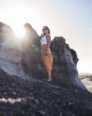 Woman on volcanic scenario illuminated Imagens