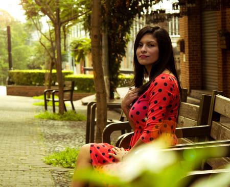 Woman sitting in autumn