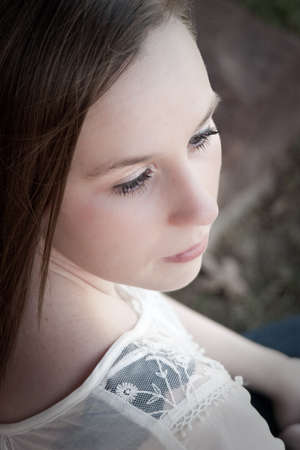 Solemn girl looking over her shoulder