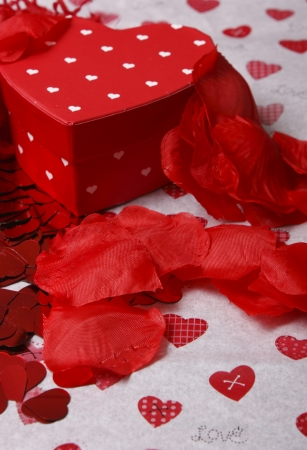 Valentines day heart shaped gift box and red petals Stock Photo