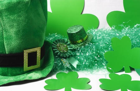An image showing the concept of St Patricks Day with a green hat and shamrocks photo