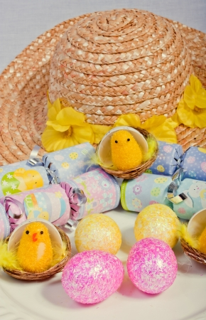 An image showing the concept of easter with a bonnet, eggs and crackers Stock Photo - 13727926