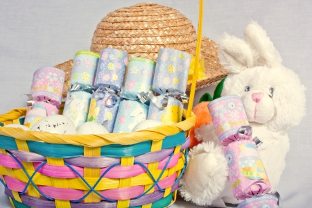 basketful: An image showing the concept of easter with a bunny, a bonnet and a basketful of crackers