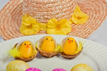An image showing the concept of Easter with chicks and a bonnet Stock Photo