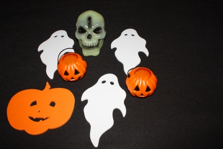 An image showing the concept of Halloween with Ghosts pumpkins and skulls  Stock Photo