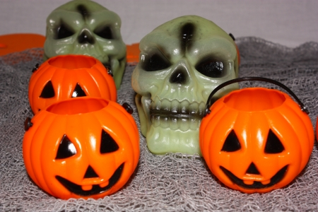 An image showing the concept of Halloween with Pumpkins & skulls Stock Photo