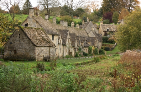english countryside: A view of the row of old weavers cottages at Arlington Row in the cotswolds