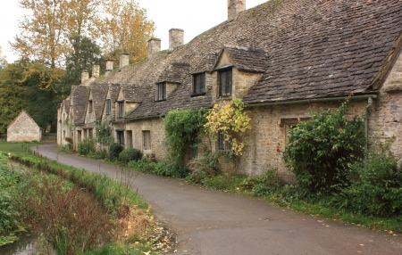 A view of the row of old weavers cottages at Arlington Row in the cotswolds Stock Photo - 16127299