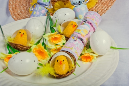 An image showing the concept of Easter with eggs, crackers and a bonne Stock Photo