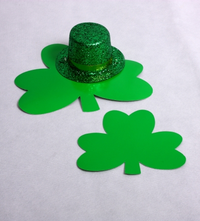 An image showing the concept of St Patricks Day with a hat and clover shapes Stock Photo - 17541321