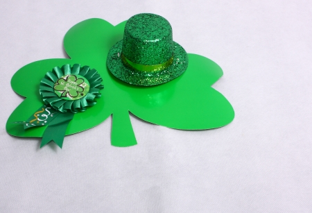 An image showing the concept of St Patricks Day with a hat and clover shapes Stock Photo - 17541320