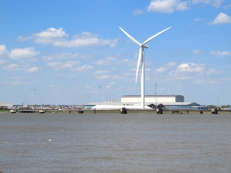An image showing wind generators and Factories by the Riverside