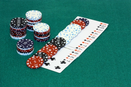 An image showing some playing cards and chips for betting with photo