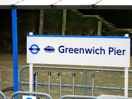 dockside: The signpost showing the dockside at Greenwich pier