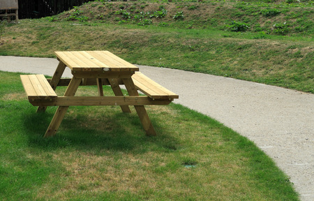 picnic table: A wooden picnic table