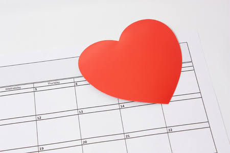The concept of Valentines day with a Heart shapes on the calender for 14th February