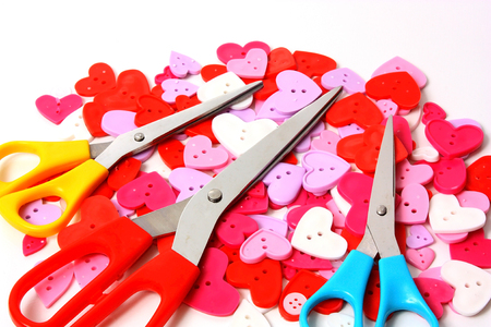 heart shaped: Pretty coloured heart shaped buttons with scissors