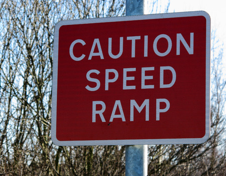 Caution speed ramp sign warning for motorists to slow down
