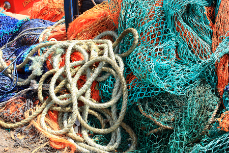 dockside: A pile of fishing nets and lengths of rope in Whitstable harbour