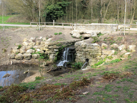 mote: A small Historic waterfall in Mote Park surrounded by old ragstone slabs
