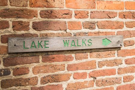 Sign showing the direction for the Lake Walks