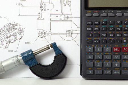 micrometer: An engineering concept image of a calculator and a micrometer Stock Photo