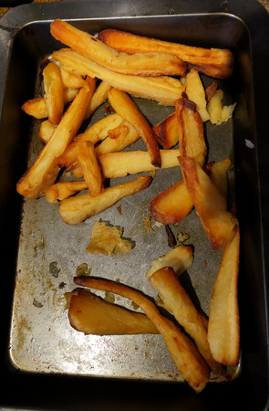 parsnips: Roasted Parsnips on a cooking tray ready to be served for dinner Stock Photo