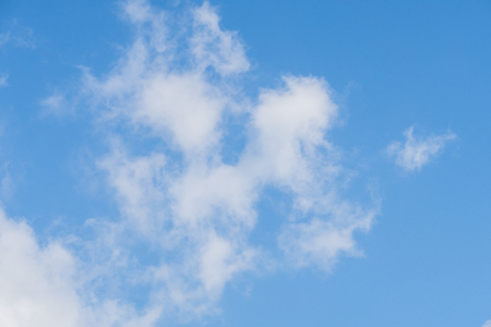 The concept of tranquility with white fluffy clouds against a blue sky