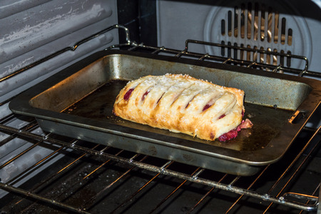 A slice of Apple Strudel cooking in the oven Stock Photo