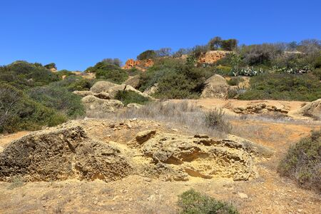 The rocky landscape of Caminho Da Baleeira nature reserve in Albufeira