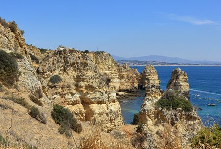 A landscape scene showing the beautiful Limestone rocky cliffs at Ponta Da Piedade Stock Photo