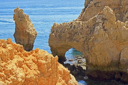Jagged rocky cliffs and limestone archways at Ponta Da Piedade