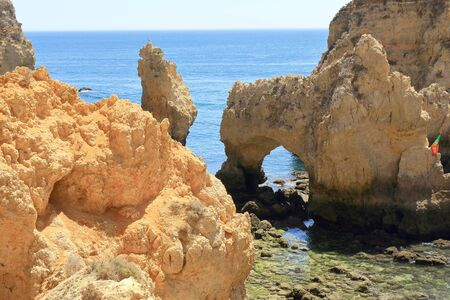 Jagged Limestone archways and pillars at the Ponta Da Piedade Headland Stock Photo
