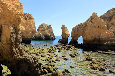 Arches and limestone pillars at the Ponta Da Piedade Headland in Lagos Stock Photo