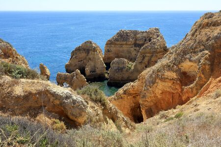 A landscape scene showing the rocky cliffs and jagged pillars at the Ponta Da Piedade headland in Lagos Stock Photo