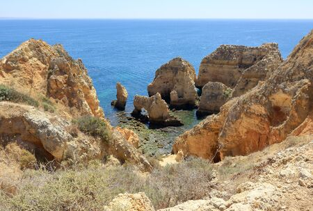 A scenic view of the jagged rocky formations and sea arches at the Ponta Da Piedade headland in Lagos