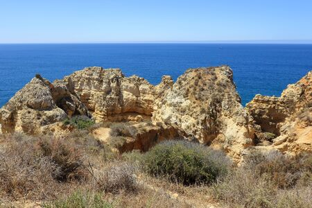 Landscape scene of the limestone rock formations at Ponta Da Piedade in Lagos Stock Photo