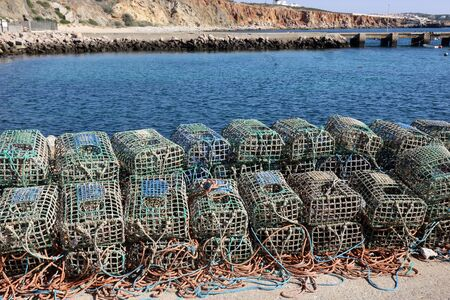 Lobster traps on the harbour wall in Rosso Do Veiga