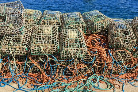 A stack of Lobster traps and colourful ropes