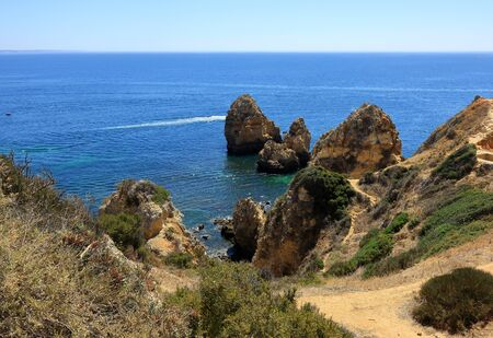 Jagged rocks and dirt tracks around the cliffs of Ponta Da Piedade