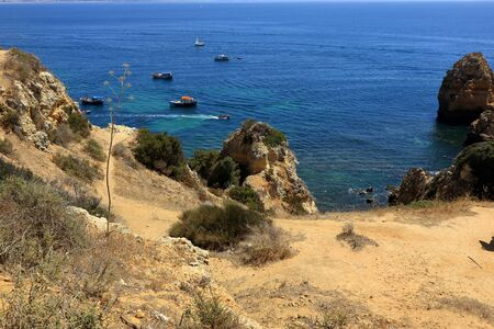 A view of the rocky cliffs overlooking the Atlantic ocean at the Ponta Da Piedade heandland