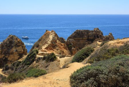 The sandy footpaths and green foliage of the Ponta Da Piedade overlooking the Atlantic ocean