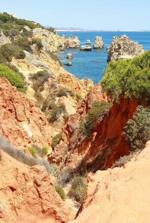 A view through the rocky cliffs to the Praia De Arrifao Stock Photo